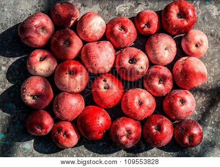 Vivid Freshly Picked Red Apples With Contrasting Shadows On The Old Metal Table Warm Filtered