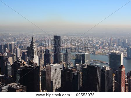 East River In New York With Skyline In Morning Smog