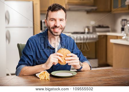 Hispanic Guy Eating A Hamburger