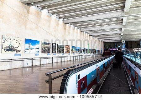 Unidentified Passengers At Horizontal Escalator At Ben Gurion Airport. Aviv. Israel