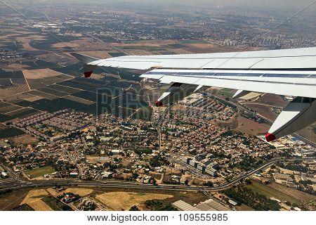 Big Passenger Jet Airplane Over Tel Aviv Environs With Soft Focus
