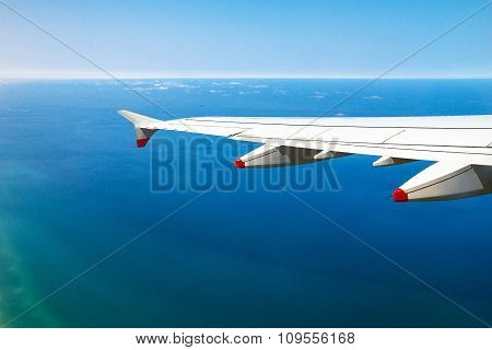 big passenger jet airplane gaining altitude over Mediterraneantel  Sea with soft focus. Israel