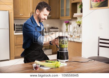 Young Man Making A Smoothie