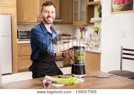 Happy Guy Making A Green Smoothie