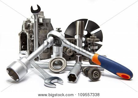 the part of car high pressure pump and the tool for repair on white background