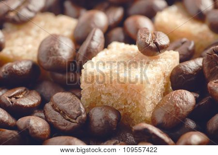 Cane Sugar Cubes Covered By Roasted Coffee Beans