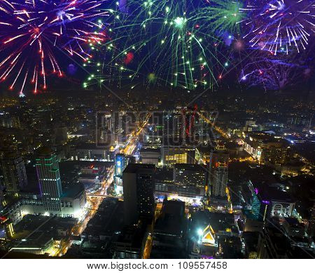 Fireworks celebrating over cityscape at night. Bangkok