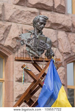Kiev, Ukraine - October 4, 2015: Monument to Taras Shevchenko and national symbols near City Hall