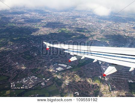 Big Airplane  Begins To Decline And Prepares For Landing In Heathrow Airport . London. Uk