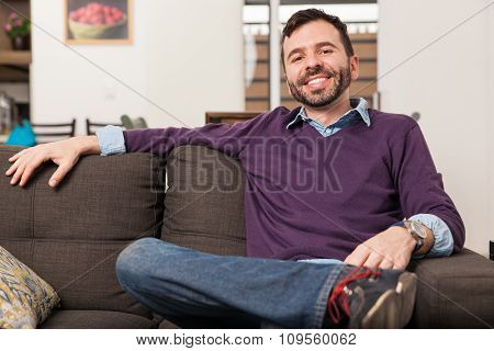 Hispanic Young Man Relaxing At Home