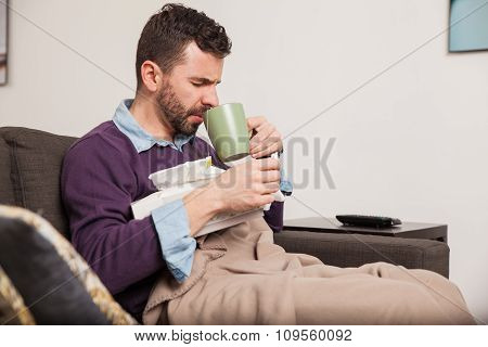 Man With A Cold Drinking Some Tea