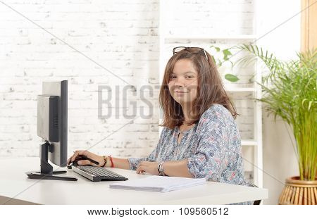 Portrait Of Teenage Girl At Her Computer