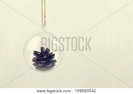 Transparent Christmas Ball With A Pine Cone Inside