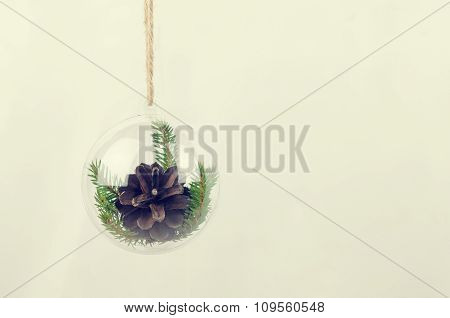 Transparent Christmas Ball With A Pine Cone Inside