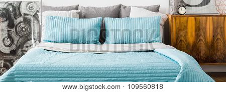 Turquoise Cushions And Bedspread