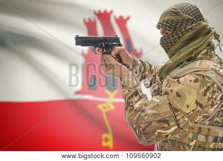 Male In Muslim Keffiyeh With Gun In Hand And National Flag On Background - Gibraltar
