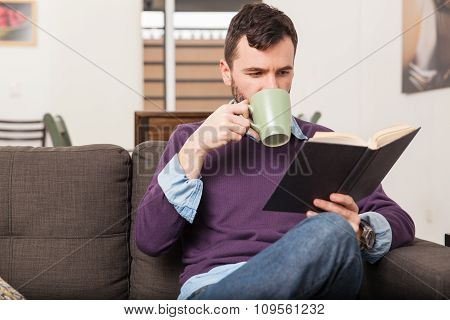 Drinking Coffee And Reading At Home