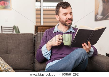 Man Relaxing And Reading At Home