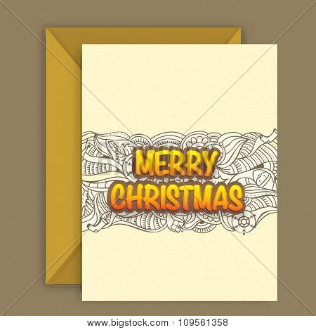 Beautiful floral design decorated greeting card with envelope for Merry Christmas celebration.