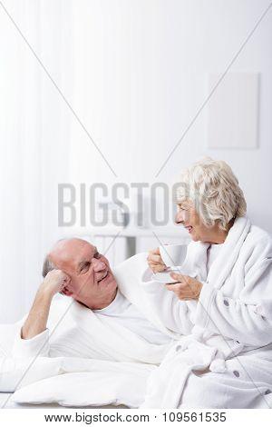 Elderly Married Couple In Bed