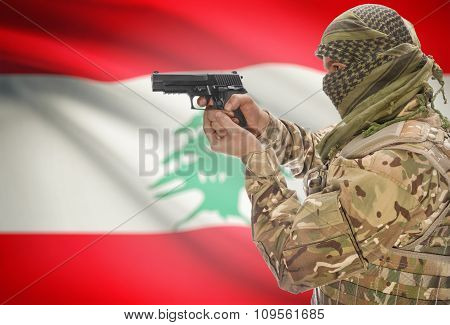 Male In Muslim Keffiyeh With Gun In Hand And National Flag On Background - Lebanon