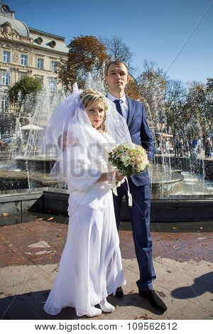 Newlyweds At The Fountain