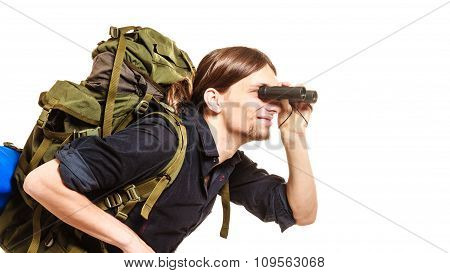 Man Tourist Backpacker Looking Through Binoculars.