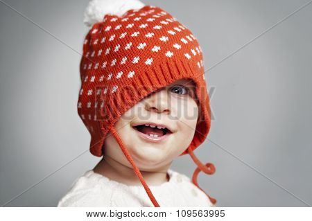 Child smiling in winter red hat