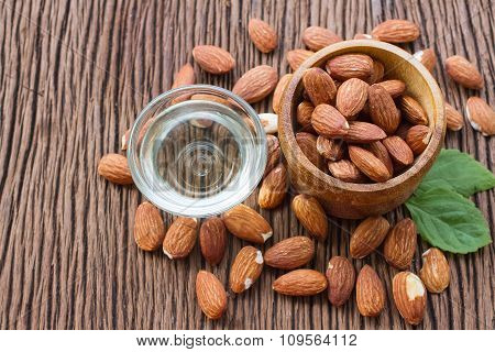 Almonds Seed And Almond Oil On Wooden Background