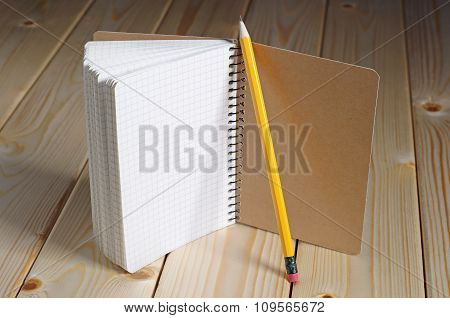 Opened Notepad And Pencil