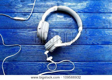 Headphones on dark blue background