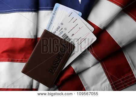 Passport, tickets lying on American Flag background
