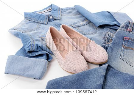 Blue denim shirt and jeans with pink shoes isolated on white background
