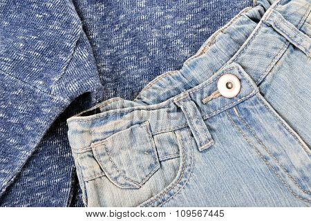 Blue denim shorts with pullover background