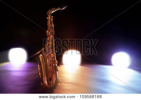 Beautiful golden saxophone on a scene