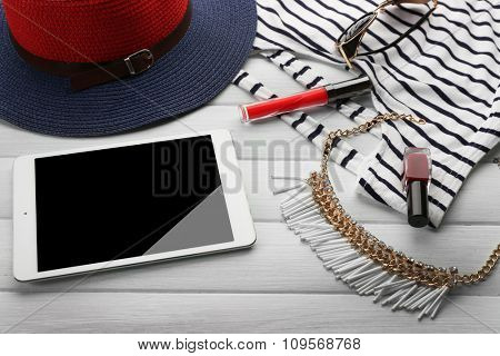 Striped fashion look on wooden background, close up