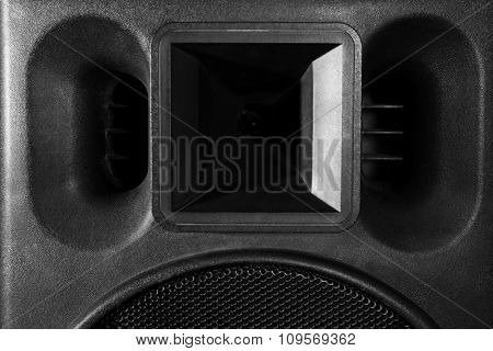 Big loudspeaker on black background, close up