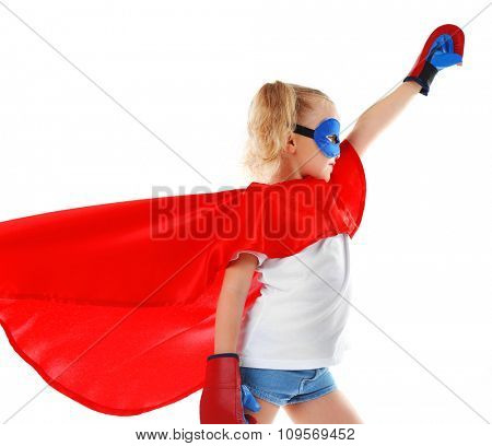 Beautiful blonde superhero little girl with boxing gloves poses in studio  isolated on white background