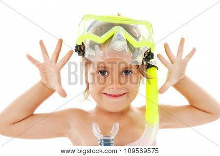 Funny little girl with yellow diving mask poses in studio isolated on white background