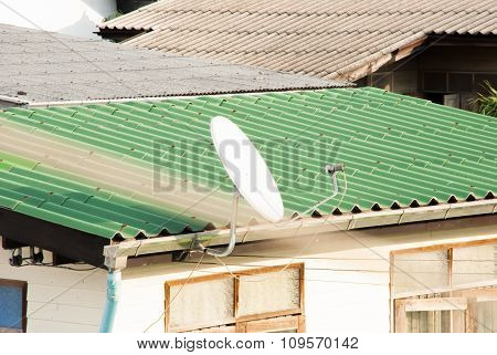White Satellite Dish On The Roof Of House