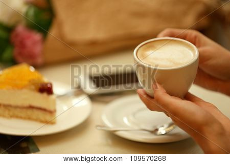 Woman with a cup of coffee in cafe