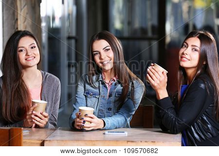 Best friends together sitting at cafes terrace