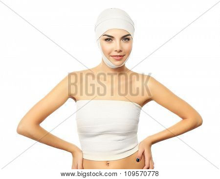 Young beautiful woman with an elastic bandage on her head and chest, isolated on white