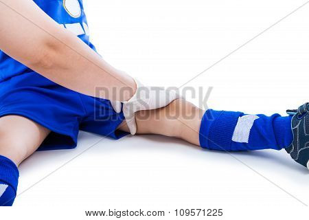 Sports Injury. Doctor First Aid At Thigh Of Soccer Player. Isolated On White.