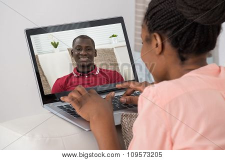 Woman Video Chatting With Man On Laptop