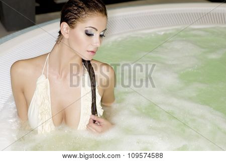 Close up portrait of pretty young adult attractive sexy and sensuality beautiful brunette woman in jacuzzi