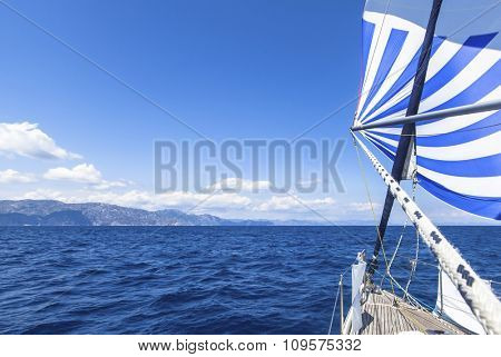 Sailing ship yachts with blue white sails in the Sea. Luxury boats.