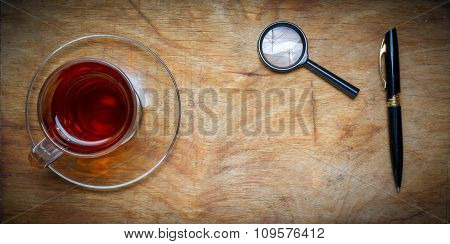 Small Notebook With A Cup Of Tea, Stick On A Rustic Wood Background.