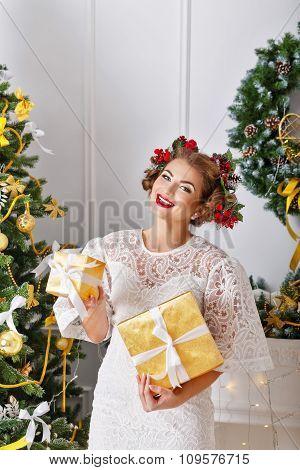 Girl Holding Christmas Gifts.