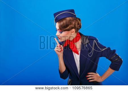 Stewardess With Face Art Asks For Silence.